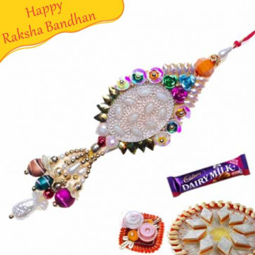 Buy Diamond And Pearls With Velvet Ball Fancy Rakhi Online on Rakshabandhan with India, worldwide delivery options