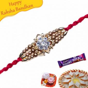 Buy Golden Ball With American Diamond Hoop Jewelled Rakhi Online on Rakshabandhan with India, worldwide delivery options