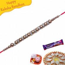 Golden Balls American Diamond Bracelet Rakhi