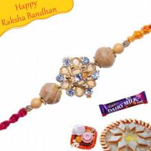 Buy Auspicious Floral Design Diamond Studed Mauli Rakhi Online on Rakshabandhan with India, worldwide delivery options